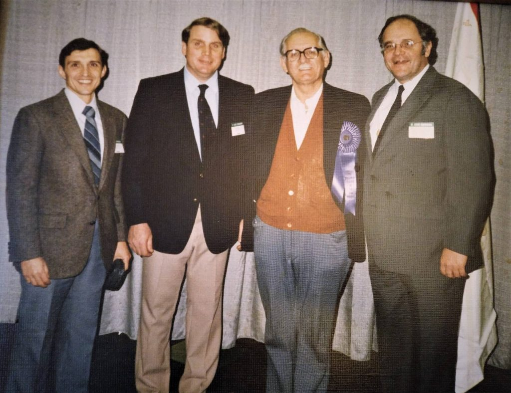 1985 in Milwaukee when Frank Douglas was awarded Teacher of the Year. L-R Santo, Kurt, Frank, and Superintendent of Public Instruction Herbert Grover.