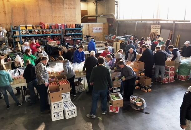 Janesville Morning Rotary Volunteers Packing Fruit Baskets