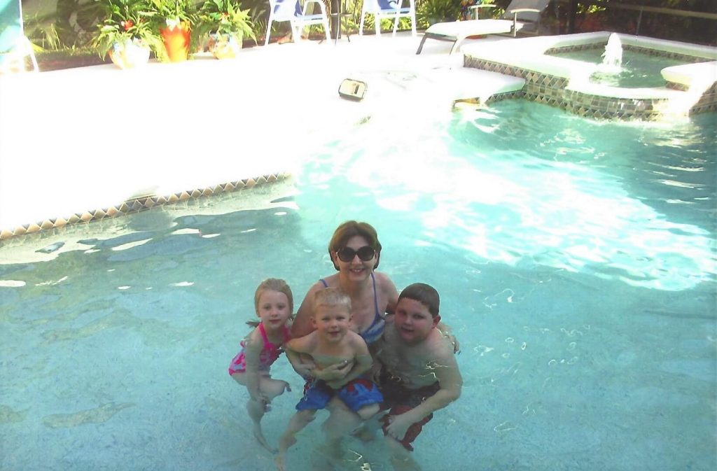 Milly in their Florida pool with the grandchildren