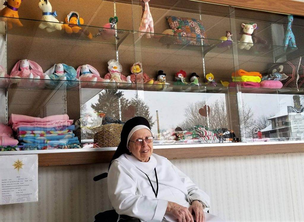 Sister Mary Denise at the Display Case at St. Elizabeth